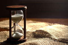 Hourglass. Time passing in contrast backlit. sandglass in sunlight royalty free stock photos