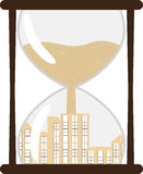 Hourglass with town inside Royalty Free Stock Image