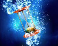 Hourglass under water Stock Image