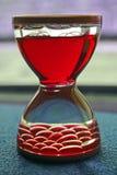 Hourglass vermelho imagens de stock royalty free