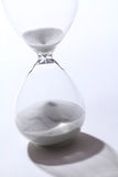 Hourglass. In white background and shadow drop Royalty Free Stock Image
