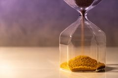 Hourglass on white table, Time passing concept Stock Image