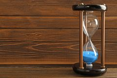 Hourglass on wooden background. Time management concept royalty free stock images