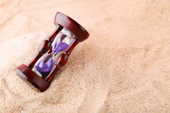 Hourglass. Wooden hourglass on the beach sand Royalty Free Stock Photos