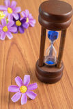 Hourglass on the wooden table Royalty Free Stock Image