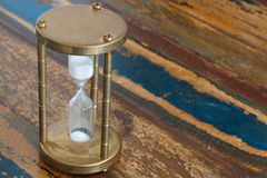 Hourglass on wooden table Royalty Free Stock Photo