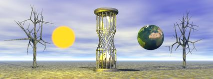 Hourglass and world and sun Stock Photos