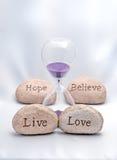 Hourglass Żywy, miłość, nadzieja i Wierzymy Obrazy Stock