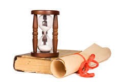 Hourglasses and book isolated Royalty Free Stock Photo