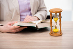 The hourglasses in business concept in time concept Stock Image