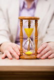 The hourglasses in business concept in time concept Royalty Free Stock Photo