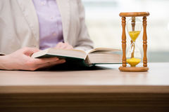The hourglasses in business concept in time concept Stock Photo