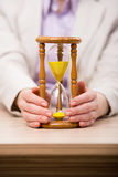 The hourglasses in business concept in time concept Stock Photography