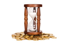 Hourglasses and coin time concept Royalty Free Stock Image