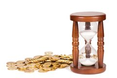 Hourglasses and coin time concept Royalty Free Stock Images