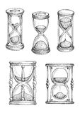 Hourglasses and sandlgasses sketches set Royalty Free Stock Photography