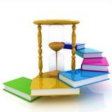 Hourglasses und Buch Stockfotos