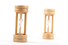Hourglasses. Wooden hourglasses  on white Royalty Free Stock Photos