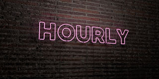 HOURLY -Realistic Neon Sign on Brick Wall background - 3D rendered royalty free stock image Royalty Free Stock Photography