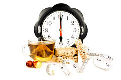 Hours at 6 pm tea and snacks. Hours at 6 pm tea and diet snacks Stock Photos