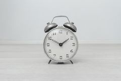 Hours an alarm clock on a white background Royalty Free Stock Images