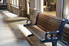 After Hours Bench. Empty bench outside storefront at night Royalty Free Stock Photos