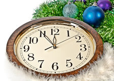 Hours and the bright New Year's ornaments. Royalty Free Stock Photography