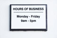 Hours of business sign Monday to Friday stock photo