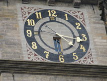 Hours. The clock on the white tower in Hradec Kralove, Czech Republic useful as a background royalty free stock photo