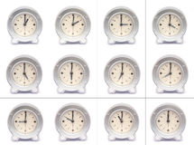 Hours of the day. All the hours of the day shown on analogue clock faces stock images