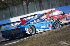 12 Hours of Sebring. Sebring, FL - Mar 14, 2014:  The Chip Ganassi Racing Telcel Riley DP takes to the track on Continental tires for a practice session for the Royalty Free Stock Images