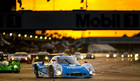 12 Hours of Sebring. Sebring, FL - Mar 15, 2014:  The Telcel Ford EcoBoost travels through turn one at sunset during the 12 Hours of Sebring at Sebring Stock Photography