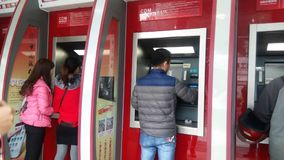 24 hours self-service bank, people in the financial services stock video footage