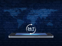24 hours service icon on modern smart phone screen over map and. Computer binary code blue background, Full time service concept, Elements of this image royalty free stock photography