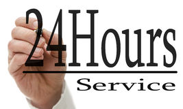24 Hours service. Male hand writing 24 Hours service on virtual screen stock illustration