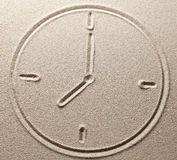 Hours with shooters are drawn on river sand. Hours with shooters are drawn on sand Royalty Free Stock Photo