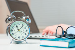 Hours show 11 hours the very heat of the working day. In the office royalty free stock photo