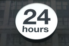 24 Hours. A sign in New York City, generally called The City That Doesn't Sleep, indicating a business is open 24 hours a day royalty free stock photos