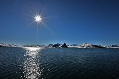 24 hours of sunshine in Svalbard June 2018. An Arctic shoreline in a fjord off Svalbard in June 2018 royalty free stock image