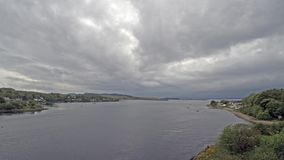 8 hours time lapse of Connel and the Falls of Lora seen from the Connel bridge. Argyll, Scotland stock video