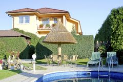 Hous and garden. House and swimming pool in sumer Royalty Free Stock Photo