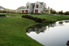 House 01. Big house in a private compound in Johannesburg, South Africa. The dam in the foreground is fed through a waterfall closeby Royalty Free Stock Photo