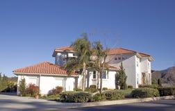 House 10. A Spanish style home under a deep blue sky Stock Photo