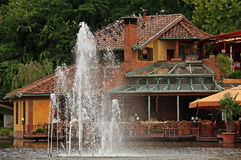 House. On a lakeside with fountain Stock Photography