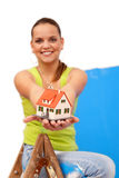 House. Young woman worker at the ladder with miniature house Royalty Free Stock Images