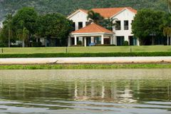 House. A house is water side , near a mountain royalty free stock photography