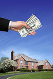 House. A brand new house for sale and hand with money Stock Photos