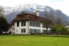 House. A house under the snowberg in swiss Royalty Free Stock Images