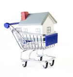 House. Shopping cart with house on white background stock images