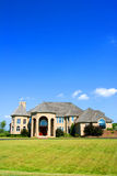 House. Beautiful house, grass and blue sky Stock Photo